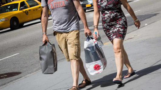 Shoppers walk down 5th Avenue in New York City.