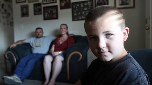 Kati and Jason Criner with their six-year-old son Terry at their home in Boise, ID