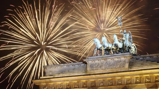 Fireworks explode over the Brandenburg Gate in Berlin, Germany