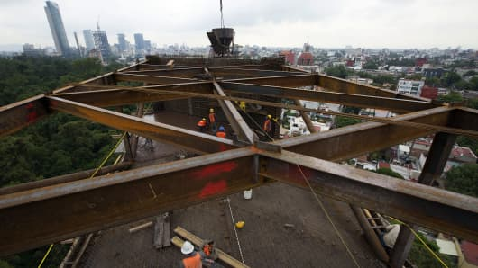 Construction workers in Mexico City, Mexico: JPMorgan says it is underweight emerging markets against developed markets