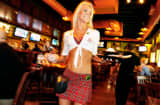 Rose Dimov serves lunch at the Tilted Kilt, in Tempe, Arizona in this May, 2012 photo.