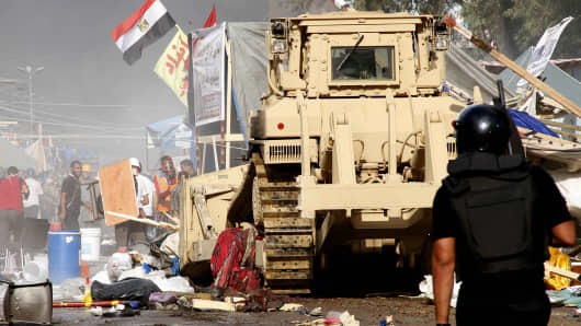 Security forces in Cairo disperse a protest camp held by supporters of ousted President Mohammed Morsi.
