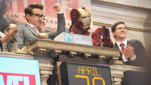 Actor Robert Downey (L) Jr.and the comic book character Iron Man ring the opening bell in celebration of 'Iron Man 3' at the New York Stock Exchange on April 30, 2013 in New York City.