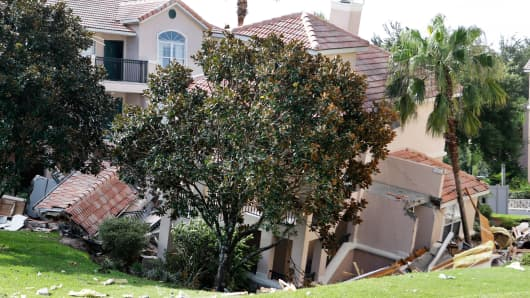 A portion of a building swallowed by a sinkhole Monday in Clermont, Fla.