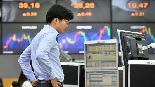 A currency trader monitors exchange rates in a dealing room at the Korea Exchange Bank in Seoul.
