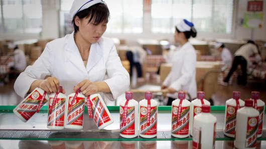 Workers  package baijiu liquor in China.