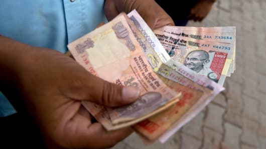India's rupee has plunged to a record lows against the dollar.