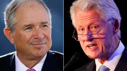 Stephen Schwarzman, chairman and chief executive officer of Blackstone Group LP and Bill Clinton, former US President and founder of the Clinton Foundation.