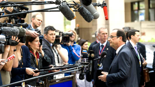 Francois Hollande, France's president speaks to the media as he arrives for the European Leaders summit at the European Council headquarters in Brussels,