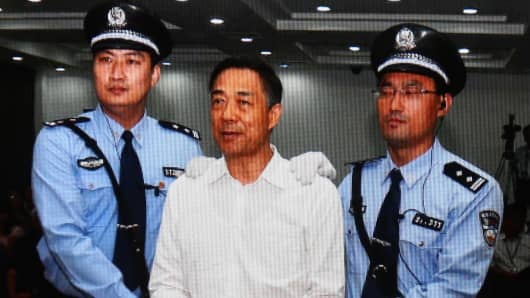 A screen shows the picture of the sentence of Chinese politician Bo Xilai (Center) on September 22, 2013 in Beijing, China.