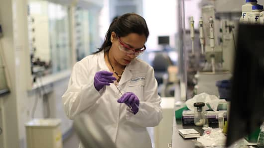 A worker in a Biogen lab.