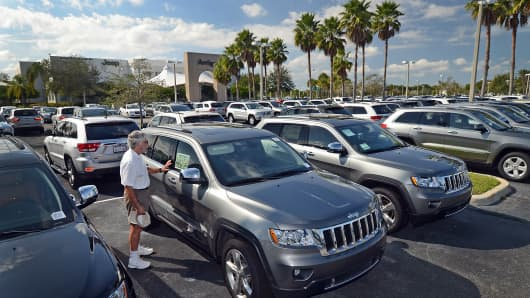 2012 Jeep Grand Cherokee vehicles at a Dodge-Chrysler Jeep car dealership in West Palm Beach, Florida.