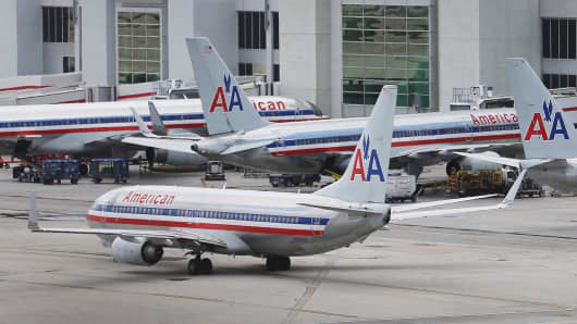 American Airlines aircraft sit on the tarmac at Miami International Airport.