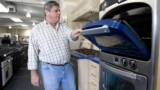 A man looks at a Turbo Chef oven at the General Appliance & Kitchen store in Berkeley, California.