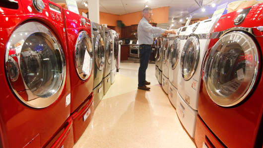 A man looks at dryers and washing machines at RC Willey appliance store in Orem, Utah.