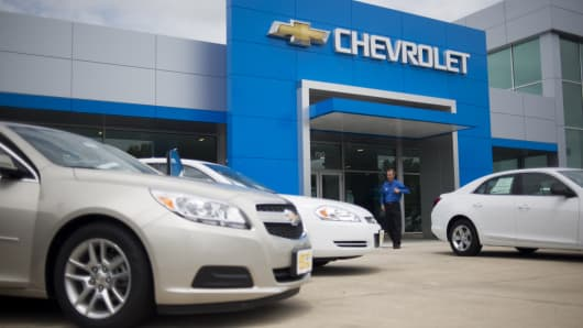 A dealer walks out of the front doors of the Jack Maxton Chevrolet dealership in Columbus, Ohio.
