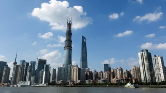 The Shanghai Tower (L), China's tallest building.