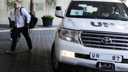 The UN chemical weapons investigation team arrives in Damascus.