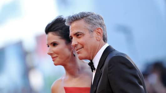 Actors Sandra Bullock and George Clooney at the 2013 Venice Film Festival