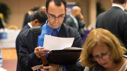 Job seeker Michael Grosberg reviews his paperwork and resume during a job fair in New York on Aug. 22, 2013.