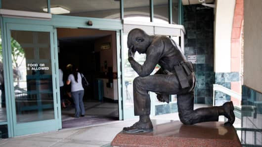 A memorial to fallen police officers stands at the entrance to the City of San Bernardino Police Department on July 12, 2012 in San Bernardino, California.
