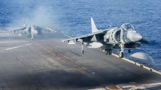 An AV-8B Harrier jet aircraft takes off from the flight deck of the forward deployed amphibious assault ship USS Bonhomme Richard (LHD 6).