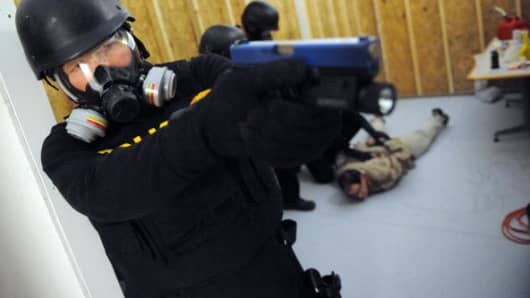US Drug Enforcement Administration (DEA) Agents simulate a raid in their Tactical Training Facility
