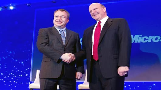 Stephen Elop, CEO of Nokia, left, shakes hands with Steve Ballmer, Microsoft's CEO, in London in 2011.