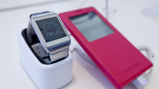 A Samsung Electronics Co. Galaxy Gear watch and Galaxy Note 3.