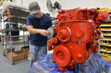 A technician works on a Cummins Inc. ISL diesel engine at the E-ONE Inc. factory, in Ocala, Florida.