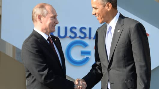 Russian President Vladimir Putin (L) welcomes US President Barack Obama at the start of the G20 summit on September 5, 2013 in Saint Petersburg.