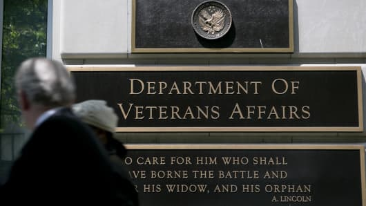 Pedestrians walk past the U.S. Department of Veterans Affairs (VA) headquarters in Washington, D.C.