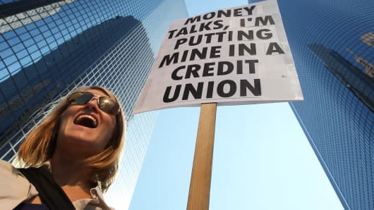 Protest against banks and in favor of credit unions.