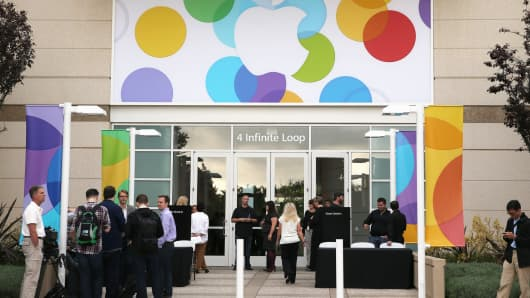 People arrive for an Apple product announcement at the Apple campus in Cupertino, Calif.
