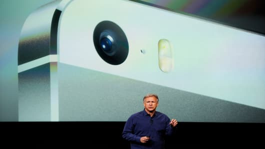 Apple's Philip Schiller introduces a new iPhone 5S during the product announcement.