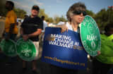 A showdown continues between Walmart and the neighboring District of Columbia, where Mayor Vincent Gray could sign a bill that would make large retailers to pay their employees a 50 percent premium over the city's minimum wage.
