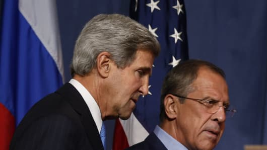 US Secretary of State John Kerry (L) and Russian Foreign minister Sergei Lavrov arrive for a joint press conference in Geneva during their meeting on Syria's chemical weapons, September 12.