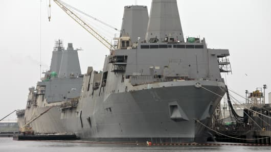 The USS Arlington, front, and USS San Diego at Ingalls Shipbuilding yard, a division of Huntington Ingalls Industries, in Pascagoula, Miss.