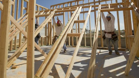 Laborers raise a wall on a new home under construction at Taylor Morrison Home Corp.'s La Solara Community in Dublin, California.