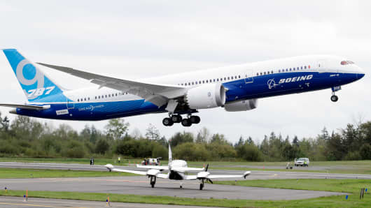 A Boeing 787-9 takes off in view of a smaller aircraft on a first flight of the new aircraft Tuesday, Sept. 17, 2013, at Paine Field in Everett, Wash.