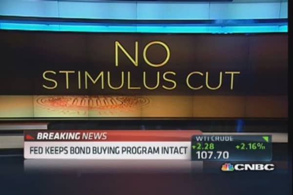 Fed keeps bond buying program intact