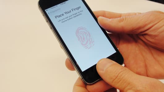 New iPhone 5S handsets let people use their fingerprints to unlock the smartphones at an iPhone event at Apple's headquarters in Cupertino, California.