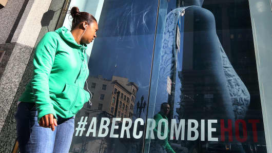 A woman stands near an Abercrombie and Fitch store in San Francisco, California.