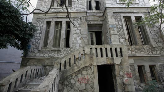 A dilapidated mansion stands for sale by the Hellenic Republic Asset Development Fund in central Athens, Greece. The government opted for online auctions as the best way to quickly and transparently move assets off its hands.