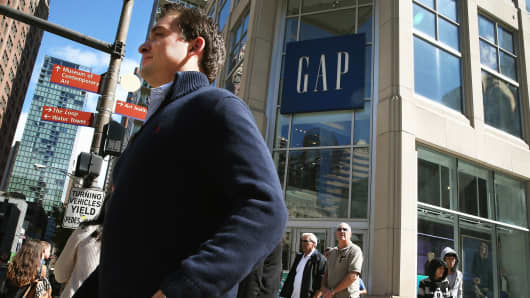 Shoppers walk past a Gap store in Chicago.
