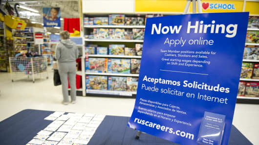 Toys R Us displays hiring signs and information to attract seasonal employees for the busiest time of year in the store.