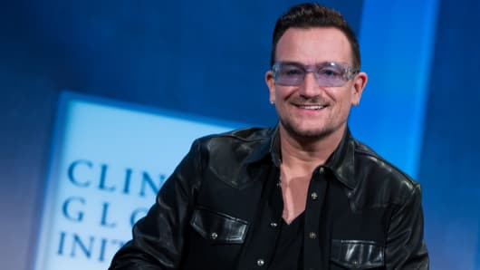 Bono participates on a panel discussing Mobilizing for Impact at the Clinton Global Initiative annual meeting in New York.