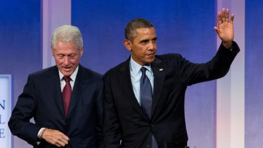 President Barack Obama discusses the Affordable Care Act with former President Bill Clinton at the Clinton Global Initiative annual meeting in New York.