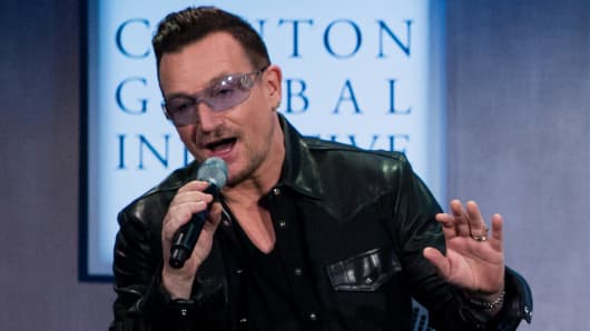 Bono stole the stage with his Bill Clinton impression ahead of a panel discussion at the Clinton Global Initiative annual meeting in New York.
