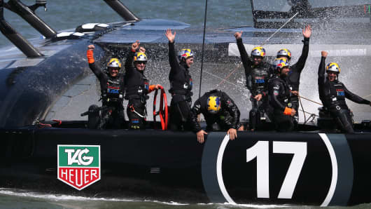 Oracle Team USA celebrates after winning the America's Cup final race on September 25, 2013 in San Francisco, California.